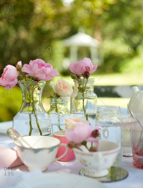 Pink and white flowers on an outdoor table