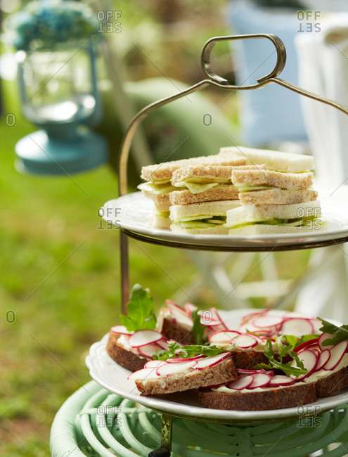 Cucumber and radish sandwiches on a serving stand