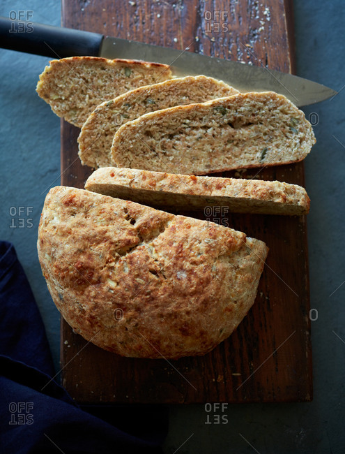 Soda bread sliced on a cutting board