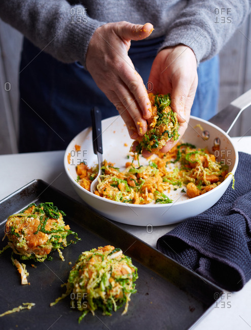 Person making savoy cabbage pot cakes
