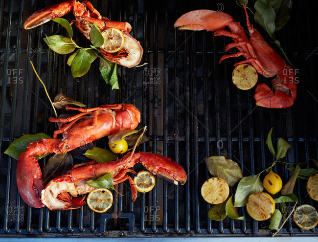 Lobster and lemon on a grill