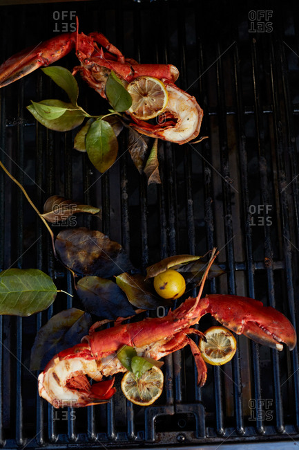 Lobster and lemon being grilled