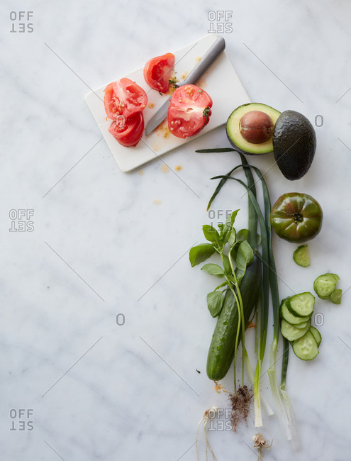 Raw vegetables on a marble countertop