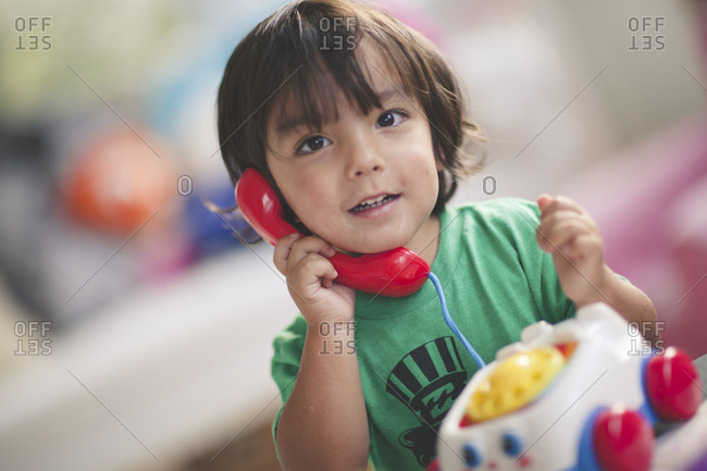 Boy playing with toy telephone