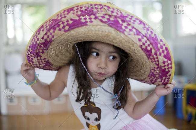 Portrait of a young girl wearing a sombrero