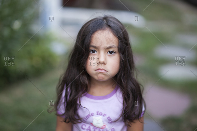 Portrait of a young girl with an unhappy face