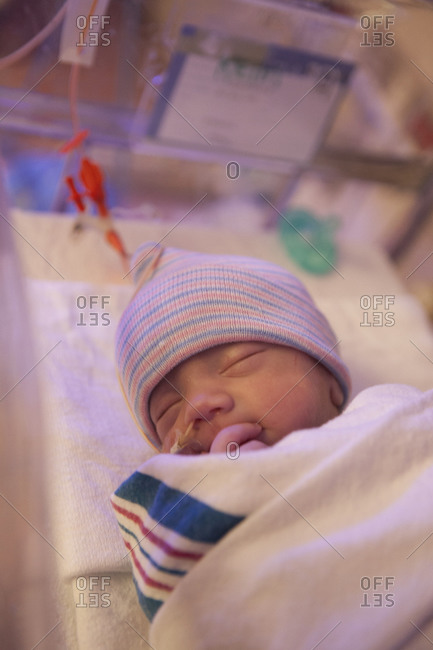 Close-up of a sleeping infant in the NICU