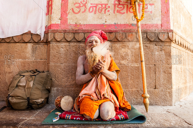 Varanasi, India - February 4, 2016:  A sadhu sitting on mat