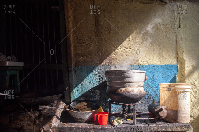Steam raising from a pot from an outdoor stove