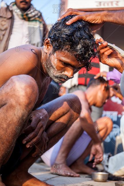 Varanasi, India - February 5, 2016: Man getting a haircut