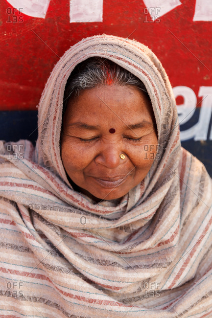 Varanasi, India - February 5, 2016: Portrait of a woman with her eyes closed