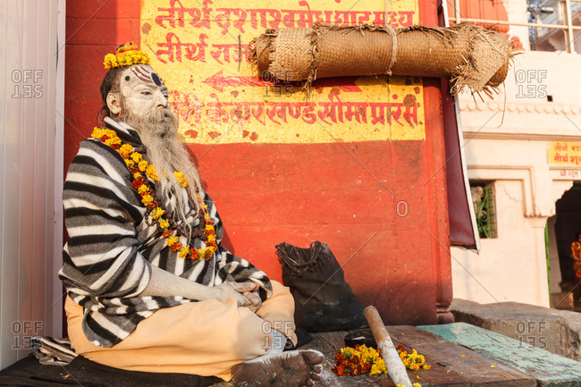Varanasi, India - February 5, 2016: A sadhu sitting cross, legged