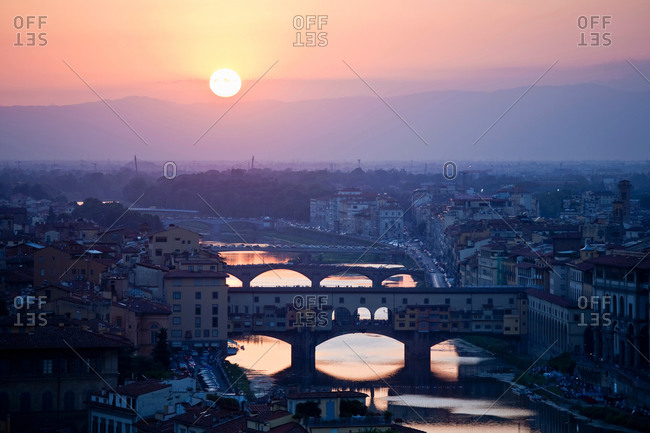 Cityscape with Arno river at sunset, Florence, Tuscany, Italy