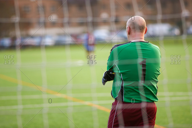 Rear view of goalie at soccer game