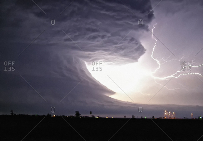An explosive cloud-to-cloud bolt shoots from this tornadic supercell with highly structured rotation, Pampa, Texas, USA