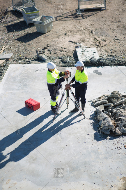 High angle view of site manager and surveyor on construction site
