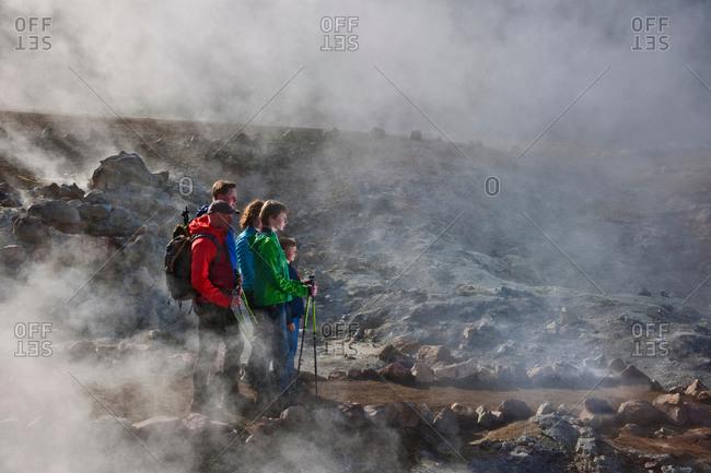 Family looking at fumarole at Landmannalaugar, Fjallabak, Iceland