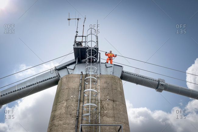 Bridge worker by himself on top of suspension bridge