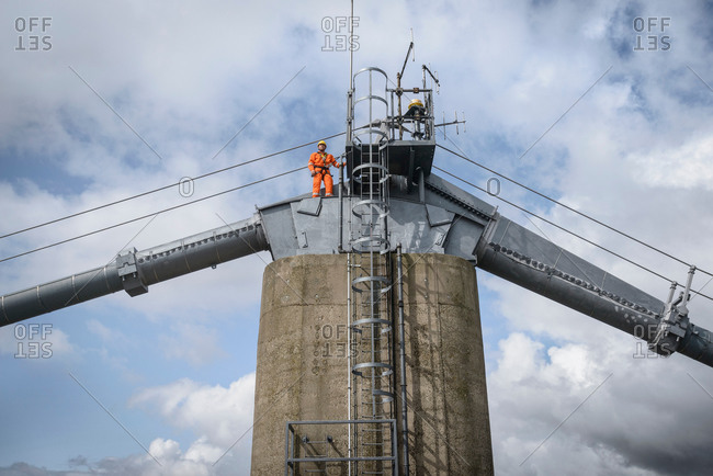 Bridge worker on top of suspension bridge