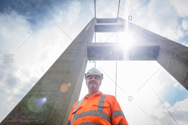 Portrait of worker on suspension bridge