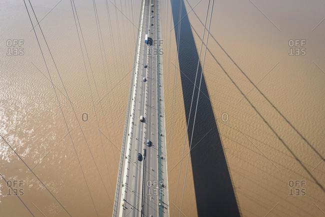 Overhead view of road on suspension bridge