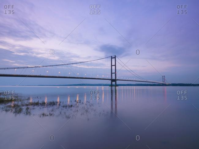 Suspension bridge at sunset - Offset