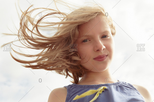 Portrait of girl with flyaway hair at breezy coast