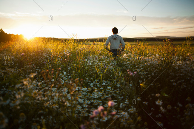 Man enjoying sunset on field, Sarsy village, Sverdlovsk region, Russia