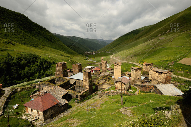 View of old ruined Svanetian towers in valley, Ushguli village, Svaneti, Georgia