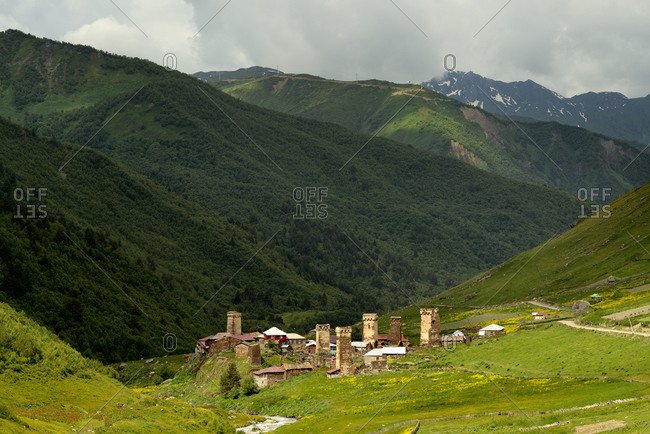 Distant view of old Svanetian towers in valley, Ushguli village, Svaneti, Georgia