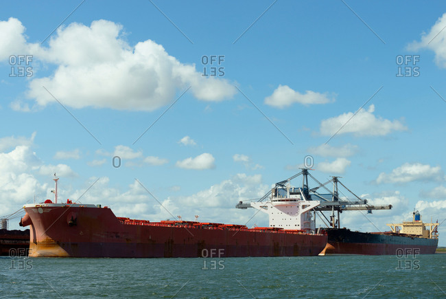 Huge ships moored in the Rotterdam harbor, used for transporting coal and iron ore