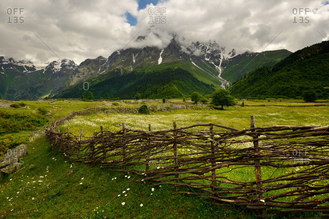 Hand woven fence and distant mountains, Mazeri village, Svaneti, Georgia