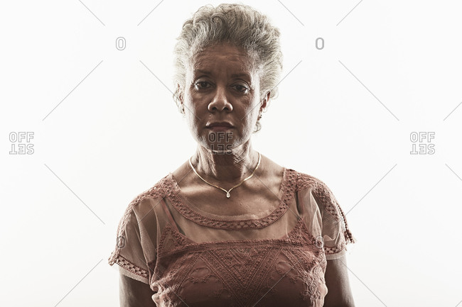 Portrait of a middle-aged woman on a white seamless background