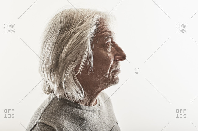 Portrait of a middle-aged man on a white seamless background