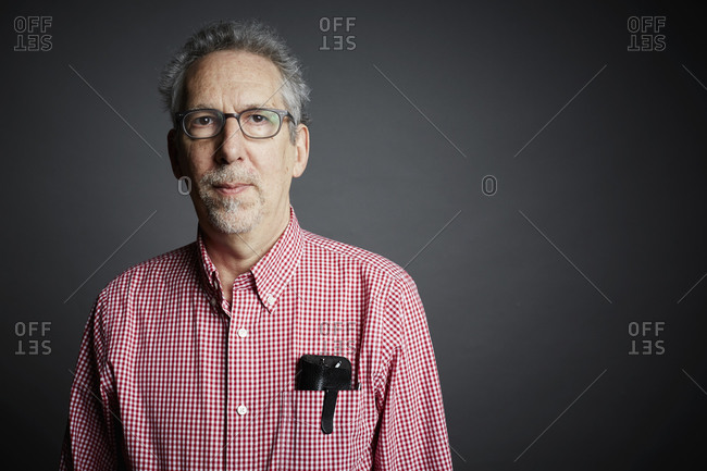 Portrait of a middle-aged man on a gray seamless background