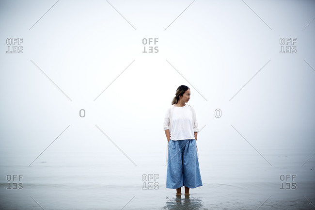 Portrait of a woman standing in ankle deep water