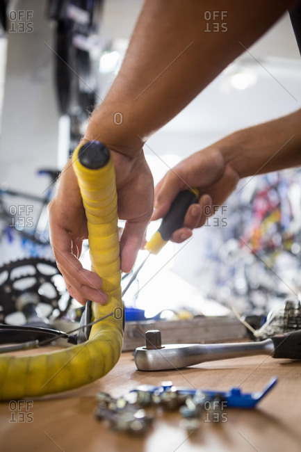 Close-up of worker repairing bicycles in a workshop