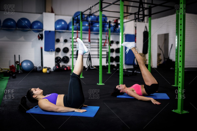 Women doing abdominal crunches at gym