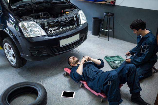 Mechanics repairing a car at the repair garage