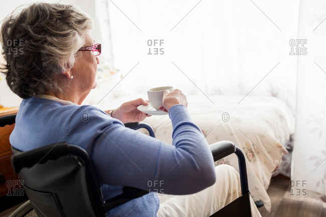 Senior woman drinking coffee in a retirement home