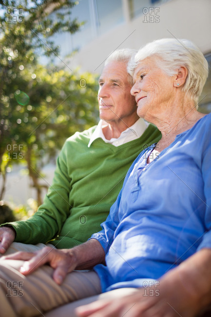 A senior couple posing together in a retirement home