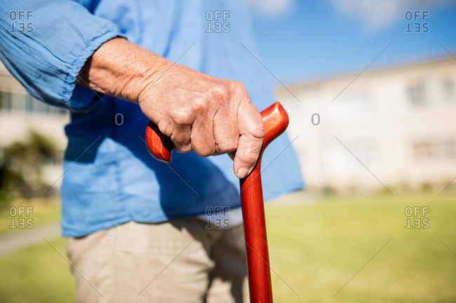 Focus on walking stick in a retirement home