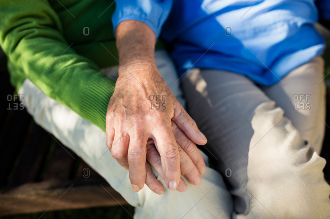 Focus on seniors couples hands in a retirement home