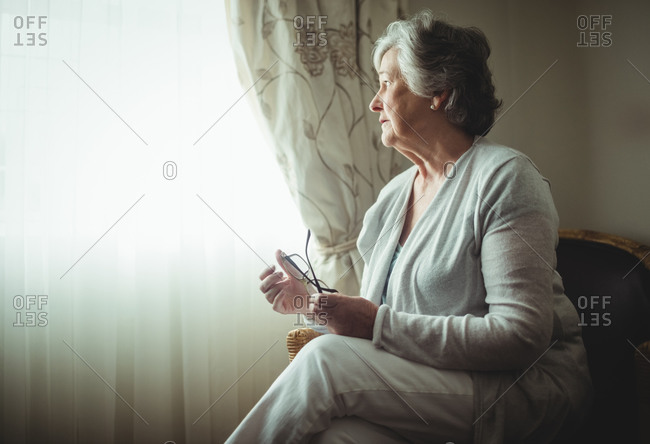 Thoughtful senior woman in a retirement home