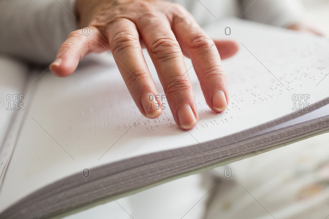 senior woman is reading in a retirement home