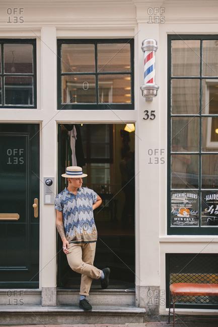 August 1, 2014: Hip man in doorway, Amsterdam