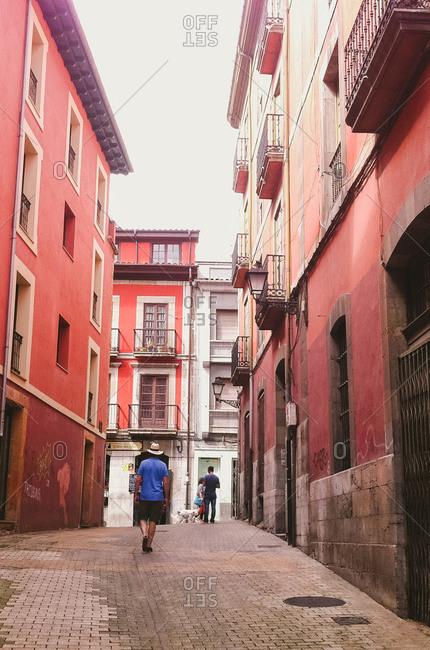 August 24, 2014: People in small street, Asturias, Spain