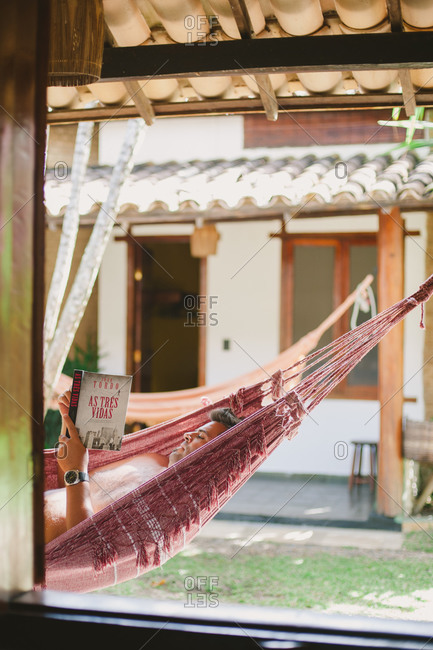 November 3, 2014: Man lying in hammock reading