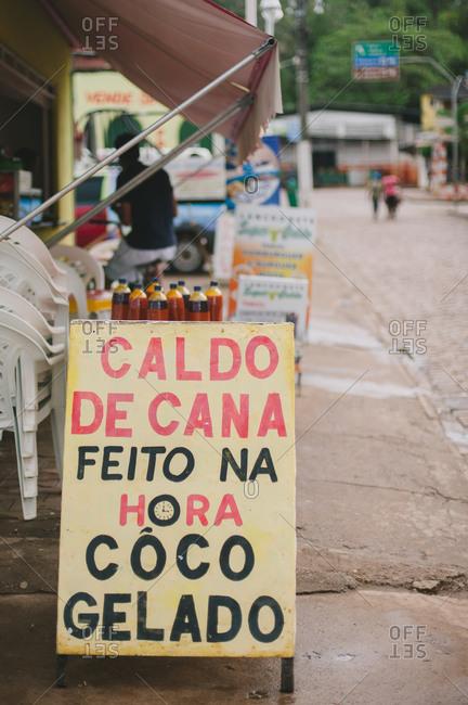 November 4, 2014: Restaurant sign on sidewalk, Brazil