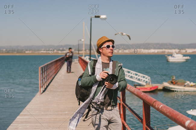 March 6, 2014: Photographer on pier, Portugal